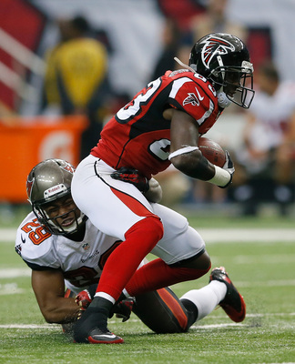 Hi-res-185429784-harry-douglas-of-the-atlanta-falcons-is-tackled-by_display_image