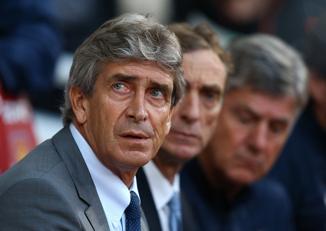 Hi-res-185354827-manager-of-manchester-city-manuel-pellegrini-looks-on_crop_650