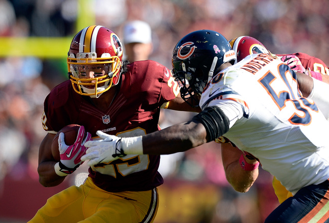 Hi-res-185435143-roy-helu-of-the-washington-redskins-runs-past-james_crop_650x440