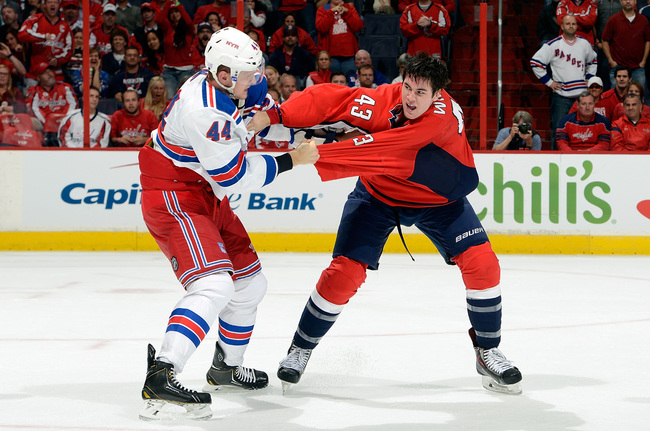 Hi-res-184800974-tom-wilson-of-the-washington-capitals-fights-in-the_crop_650