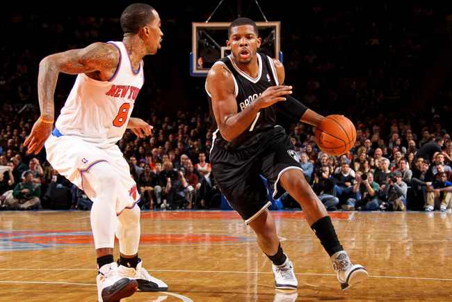 Hi-res-159847947-joe-johnson-of-the-brooklyn-nets-drives-against-j-r_crop_650