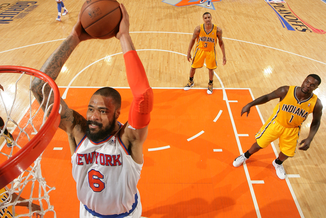 Hi-res-168284336-tyson-chandler-of-the-new-york-knicks-shoots-past-david_crop_650