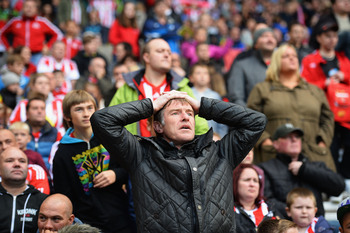 Hi-res-180528805-sunderland-fan-shows-his-frustration-during-the_display_image