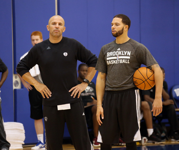 Hi-res-183101343-head-coach-jason-kidd-and-deron-williams-of-the_display_image