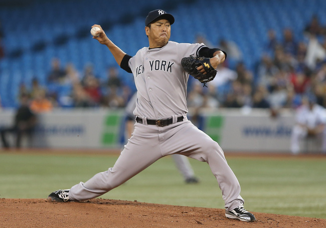 Hi-res-181192601-hiroki-kuroda-of-the-new-york-yankees-delivers-a-pitch_crop_650