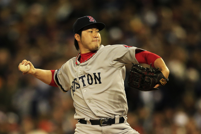 Hi-res-185159139-junichi-tazawa-of-the-boston-red-sox-pitches-in-the_crop_650