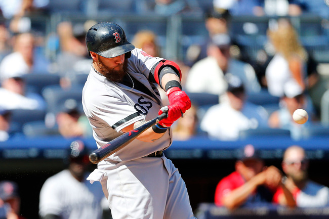 Hi-res-179934854-jonny-gomes-of-the-boston-red-sox-connects-on-a-third_crop_650