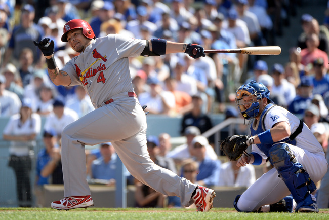 Hi-res-184788493-yadier-molina-of-the-st-louis-cardinals-grounds-into-a_crop_650