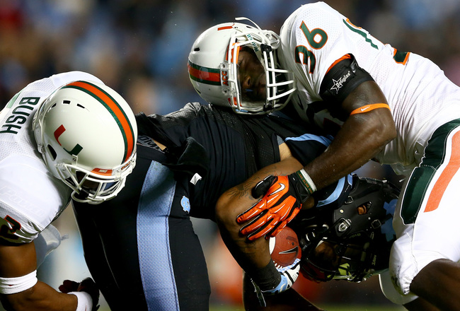 Hi-res-185153750-alex-figueroa-of-the-miami-hurricanes-tackles-eric_crop_650x440