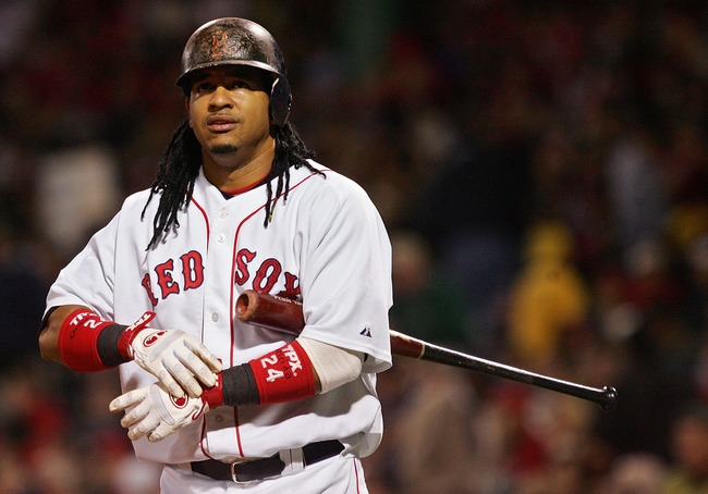 Hi-res-77504626-manny-ramirez-of-the-boston-red-sox-adjusts-his-glove_crop_650