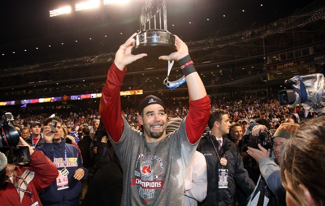 Hi-res-77544178-mike-lowell-of-the-boston-red-sox-holds-the-mvp-trophy_crop_650