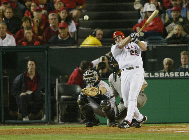Hi-res-2005943-troy-glaus-of-the-anaheim-angels-hits-the-ball-against_crop_650