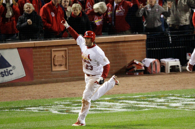 Hi-res-130660784-david-freese-of-the-st-louis-cardinals-celebrates-after_crop_650