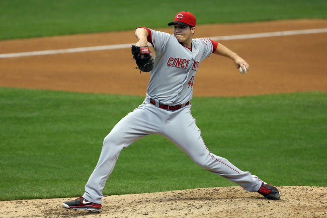 Hi-res-180651528-manny-parra-of-the-cincinnati-reds-throws-in-9th-inning_crop_650