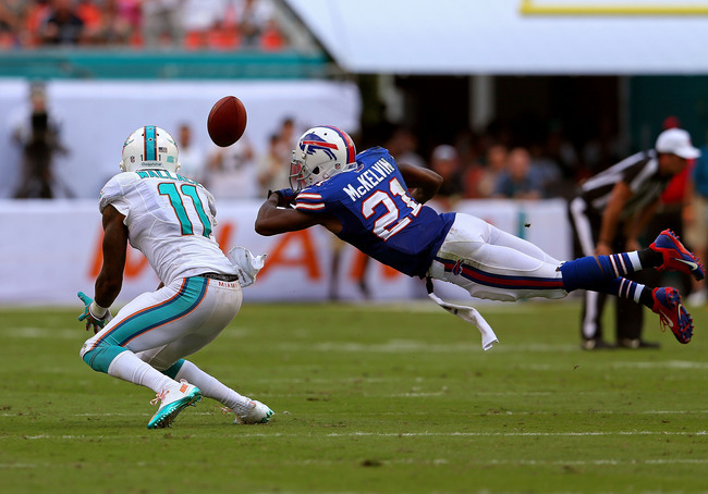 Hi-res-185429853-mike-wallace-of-the-miami-dolphins-has-a-pass-knocked_crop_650