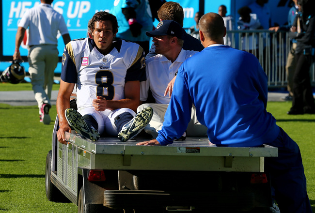 Hi-res-185429561-sam-bradford-of-the-st-louis-rams-is-carted-off-the_crop_650x440
