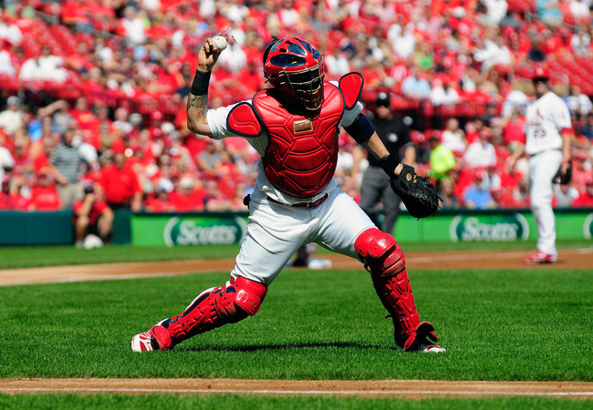 Hi-res-181806865-yadier-molina-of-the-st-louis-cardinals-throws-out-ryan_crop_650