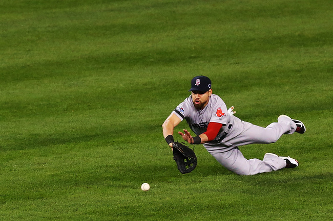 Hi-res-185156698-jacoby-ellsbury-of-the-boston-red-sox-dives-to-field-a_crop_650
