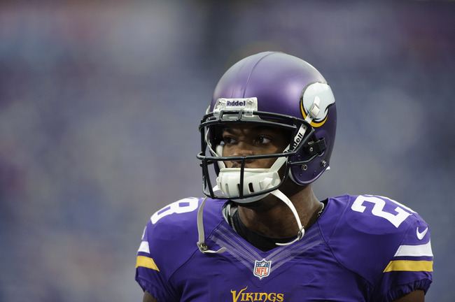 Hi-res-185103715-adrian-peterson-of-the-minnesota-vikings-looks-on_crop_650