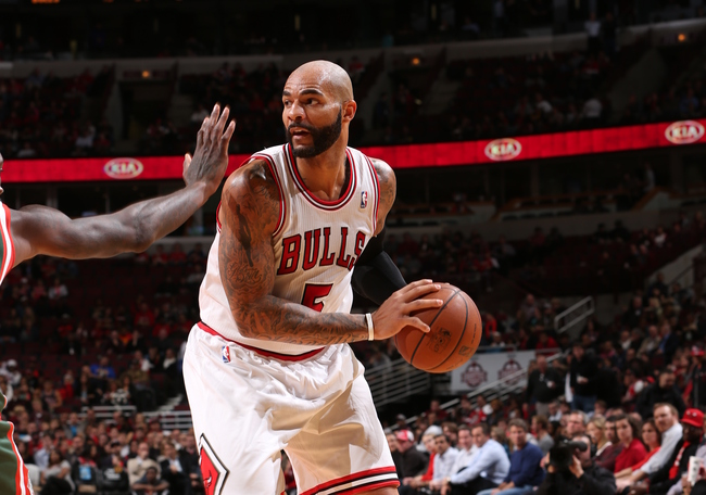 Hi-res-185509063-carlos-boozer-of-the-chicago-bulls-looks-to-pass-the_crop_650