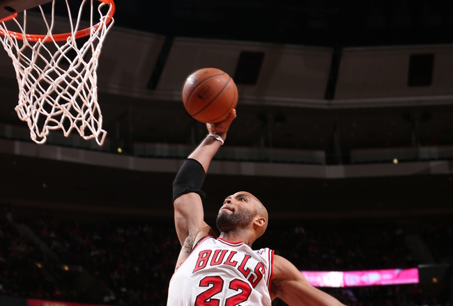 Hi-res-185509058-taj-gibson-of-the-chicago-bulls-goes-up-for-the-dunk_crop_650