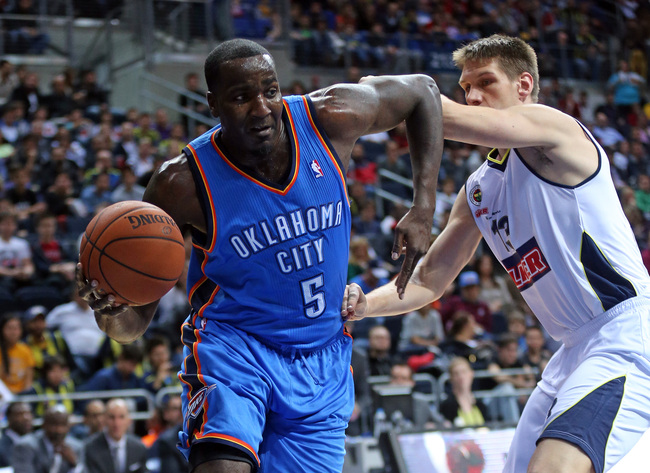 Hi-res-183158949-kendrick-perkins-of-the-oklahoma-city-thunder-drives-to_crop_650