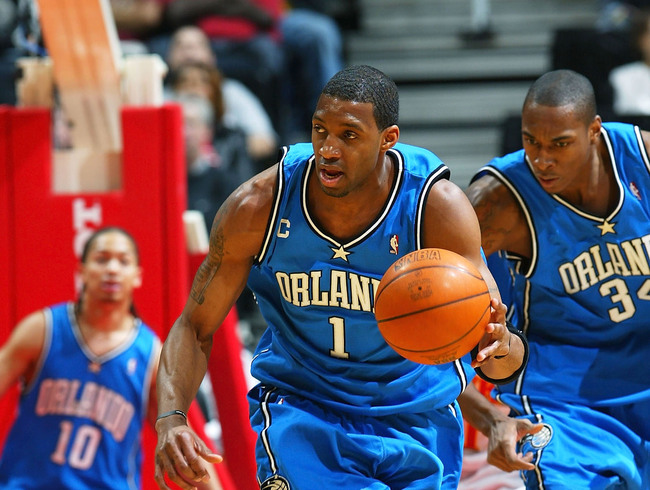 Hi-res-3023675-tracy-mcgrady-of-the-orlando-magic-carries-the-ball_crop_650