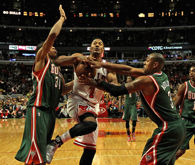 Hi-res-185516044-derrick-rose-of-the-chicago-bulls-is-fouled-by-caron_crop_650