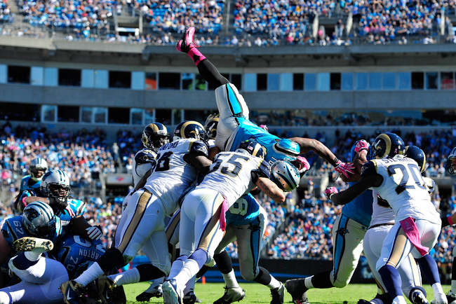 CHARLOTTE, NC - OCTOBER 20:  Kendall Langford #98 and James Laurinaitis #55 of the St. Louis Rams stop Mike Tolbert #35 of the Carolina Panthers short of the goal line during play at Bank of America Stadium on October 20, 2013 in Charlotte, North Carolina