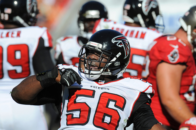 TAMPA, FL - NOVEMBER 25: Linebacker Sean Weatherspoon #56 of the  Atlanta Falcons celebrates after a tackle against the Tampa Bay Buccaneers November 25, 2012 at Raymond James Stadium in Tampa, Florida.  The Falcons won 24 - 23. (Photo by Al Messerschmidt