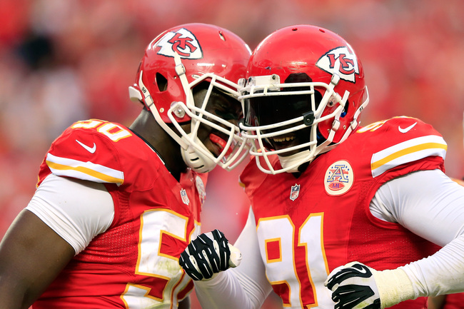 KANSAS CITY, MO - OCTOBER 20:  Outside linebacker Tamba Hali #91 of the Kansas City Chiefs is congratulated by outside linebacker Justin Houston #50 after sacking quarterback Case Keenum #7 of the Houston Texans late in the 2nd half of the game at Arrowhe