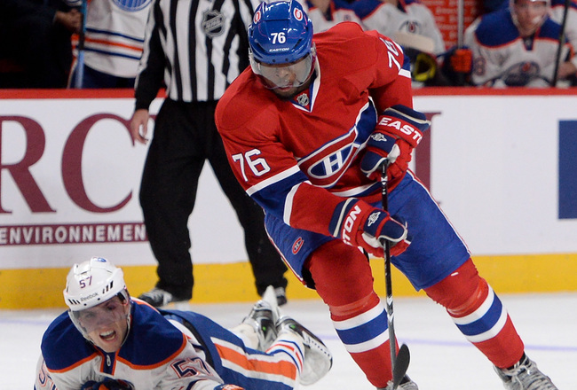 Hi-res-185607847-subban-of-the-montreal-canadiens-skates-for-the-puck_crop_650x440