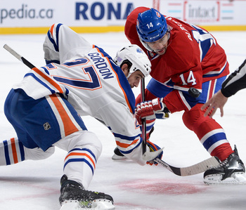 Tomas Plekanec takes a faceoff against Edmonton.