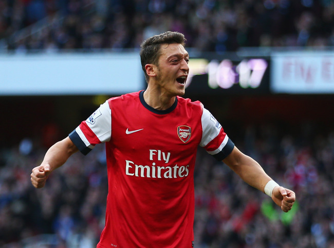 Hi-res-185350281-mesut-oezil-of-arsenal-celebrates-as-he-scores-their_crop_650