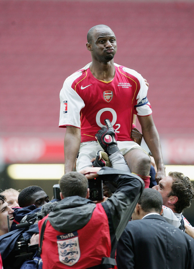 Hi-res-52962456-arsenal-captain-patrick-vieira-is-held-on-team-mates_crop_650