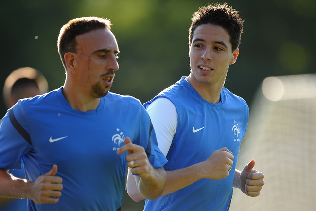 Hi-res-146684350-samir-nasri-of-france-talks-with-franck-ribery-as-they_crop_650