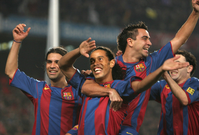 Hi-res-51770444-barcelonas-ronaldinho-celebrates-beside-rafael-marquez_crop_650