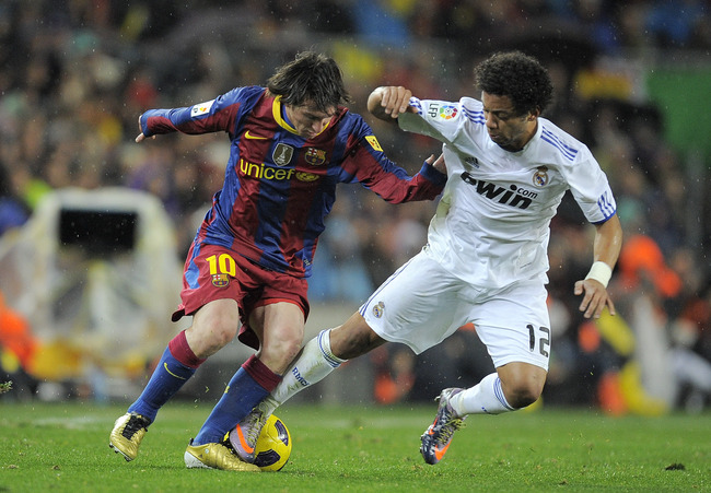 Hi-res-107208694-lionel-messi-of-barcelona-takes-the-ball-past-marcelo_crop_650