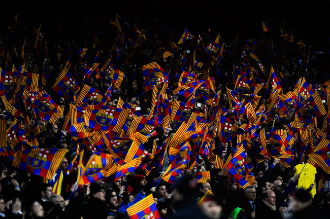 Hi-res-162786435-barcelona-supporters-wave-flags-during-the-copa-del-rey_crop_650