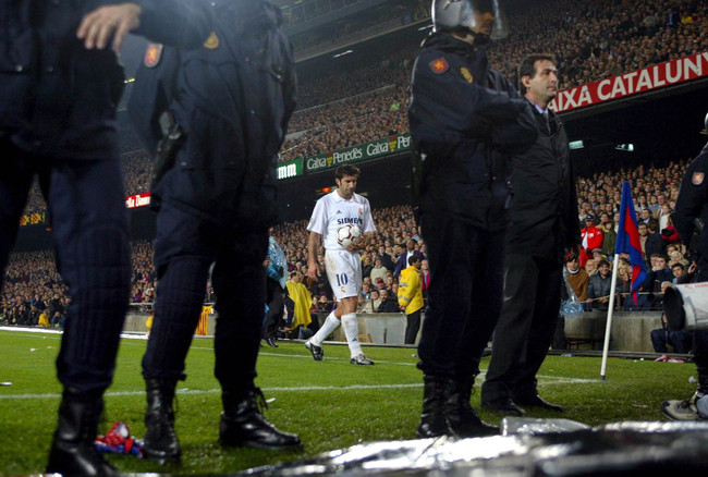 Hi-res-1663163-luis-figo-of-real-madrid-prepares-to-take-a-corner-with-a_crop_650