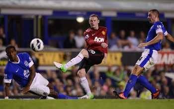 Hi-res-150535934-wayne-rooney-of-manchester-united-shoots-at-goal-during_display_image