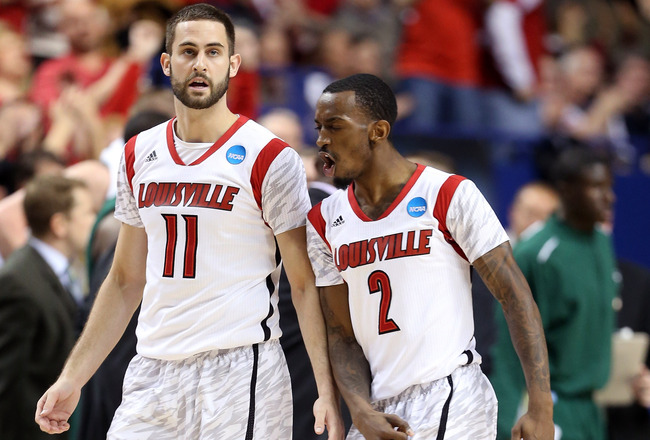 Hi-res-164411336-luke-hancock-and-russ-smith-of-the-louisville-cardinals_crop_650x440