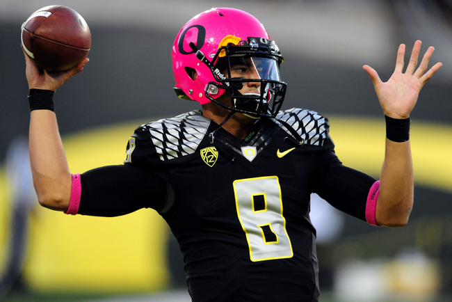 Hi-res-185373919-quarterback-marcus-mariota-of-the-oregon-ducks-wears-a_crop_650