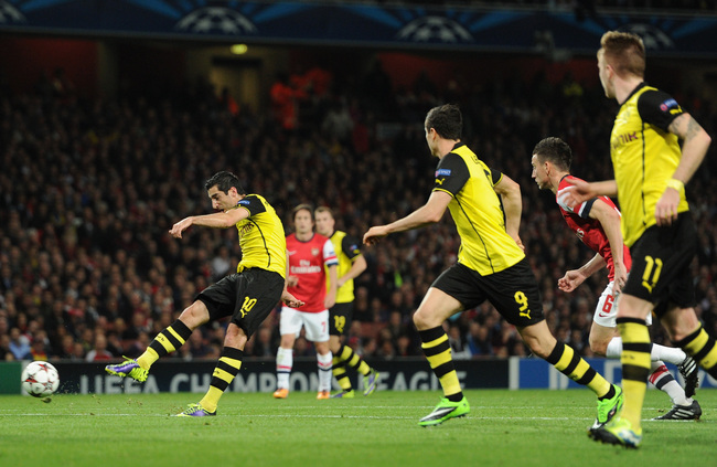 Hi-res-185579053-henrik-mkhitaryan-of-borussia-dortmund-scores-the-first_crop_650