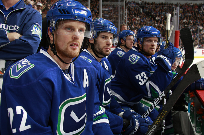 Hi-res-107983128-ryan-kesler-daniel-sedin-and-twin-brother-henrik-sedin_crop_650