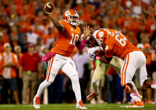 Hi-res-185376318-tajh-boyd-of-the-clemson-tigers-drops-back-to-pass_crop_650