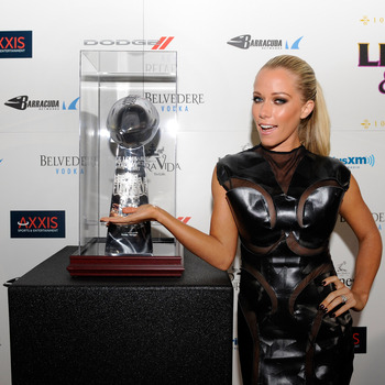 Hi-res-160517664-kendra-wilkinson-poses-with-the-lombardi-trophy-at-the_display_image