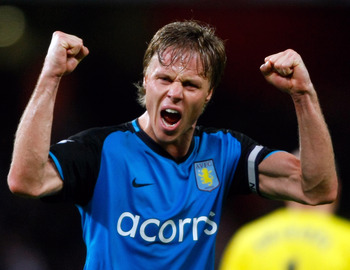 Hi-res-83704240-martin-laursen-of-aston-villa-celebrates-after-they-won_display_image