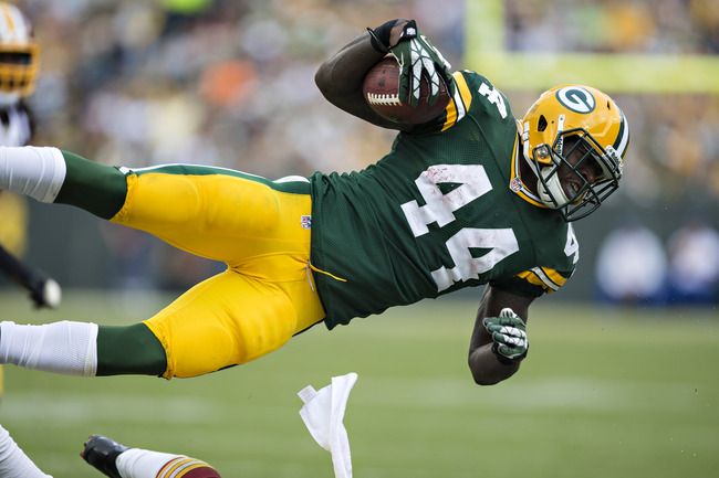Hi-res-180648411-james-starks-of-the-green-bay-packers-sails-through-the_crop_650