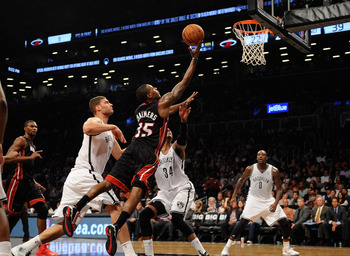 Hi-res-185153796-mario-chalmers-of-the-miami-heat-shoots-over-paul_display_image